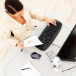 Royalty-Free Stock Photo: Business woman working on computer at desk