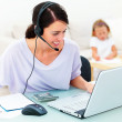 Young mother working from home - Stock Photo