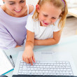 Royalty-Free Stock Photo: Happy young mother with her daughter using laptop