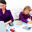 Young woman or mother working from home - Stock Photo