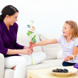 Royalty-Free Stock Photo: Daughter giving flowers to mother
