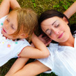 Royalty-Free Stock Photo: Family - Two sisters lying on grass