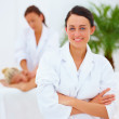 Young attractive female therapist at spa - Stock Photo