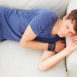 Royalty-Free Stock Photo: Young guy sleeping on sofa in home