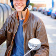 Royalty-Free Stock Photo: Happy handsome teenage boy riding a motorcycle