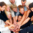 Closeup of a group of smiling friends with hands on hands - Stok fotoğraf