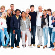 Group of happy friends standing against white background - Stock Photo