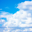 Blue sky and white fluffy clouds - Stock fotografie