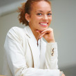 Royalty-Free Stock Photo: Pretty happy business woman standing with hands on chin