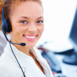 Royalty-Free Stock Photo: Closeup of a happy beautiful executive wearing headset