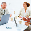 Royalty-Free Stock Photo: Happy colleagues having a business meeting against white backgro