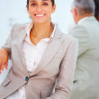 Closeup portrait of a smiling business woman standing with execu - Stockfoto