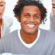 Closeup portrait of a happy young business man with two women is - Stockfoto