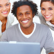 Closeup portrait of a smiling young business man with two women - Stockfoto
