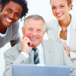 Closeup of a happy business man with executives - Lizenzfreies Foto