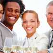 Royalty-Free Stock Photo: Closeup of smiling business having champagne against whit