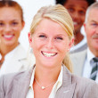 Royalty-Free Stock Photo: Closeup of a happy business woman with executives against white