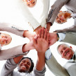 Royalty-Free Stock Photo: Young business colleagues showing unity