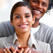 Happy young African American man with hands around woman - Stockfoto