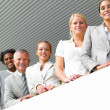 Royalty-Free Stock Photo: Smiling businesspeople standing in a line