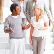 Royalty-Free Stock Photo: Laughing businesspeople standing on steps,