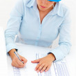 Royalty-Free Stock Photo: Female architect working on blue prints, isolated on white backg