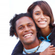 Royalty-Free Stock Photo: Closeup portrait of young man carrying a woman against white