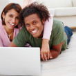 Royalty-Free Stock Photo: Portrait of a happy couple smiling with a laptop