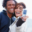 Royalty-Free Stock Photo: Happy young couple photographing themselves