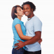 Royalty-Free Stock Photo: Woman kissing a smiling man on cheeks against white