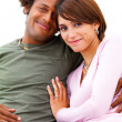 Young couple sitting and smiling - Stock Photo
