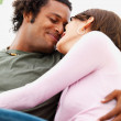 Portrait of young couple romancing - Stock Photo