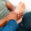 Royalty-Free Stock Photo: Man massaging woman\'s feet