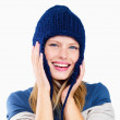 Happy young woman wearing knitted hat smiling on white - Foto de Stock