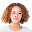 Closeup portrait of a girl with curly hair isolated on white bac - Foto de Stock