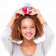 Royalty-Free Stock Photo: Portrait of a girl holding a gift on head isolated on white back