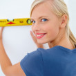Royalty-Free Stock Photo: Closeup of a pretty girl checking spirit level indication