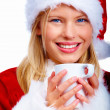 Royalty-Free Stock Photo: Closeup of a cute happy Santa lady holding a coffee cup isolated