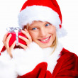Closeup of a cute Santa lady holding a gift isolated on white ba - Stock Photo