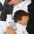 Top view of a business man sleeping on desk - Stok fotoğraf