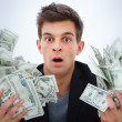 Closeup of a young business man holding money - Stock Photo