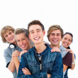 Young  friends standing in a row with man in front - Stock Photo