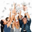 Happy celebrating with money raining - Stock Photo