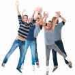 Excited young students jumping for joy - Foto Stock