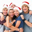 Happy group of friends celebrating christmas - Stock Photo