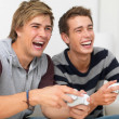 Closeup portrait of two friends playing video game - Foto Stock