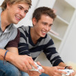 Closeup portrait of two friends playing video game - Stock Photo