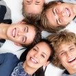 Group - Happy young friends with their heads together - Stock Photo