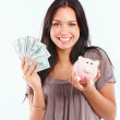 Closeup of a young woman with cash and piggybank isolated on whi - Stock Photo