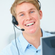 Young businessman smiling ready to help - Stock Photo